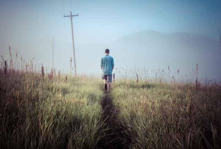 man person walking field